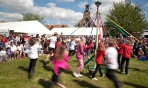 Children from a local primary school dancing round the maypole on May Day.