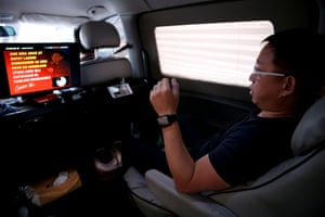 Ferdinand Tan, 53, wealth coach and motivational speaker, rehearses his lines in his van while on his way to a speaking engagement in Cainta city