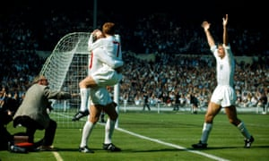 Alan Ball jumps on goalscorer Geoff Hurst as Roger Hunt joins the celebrations en route to victory over Argentina in a bad tempered quarter-final.