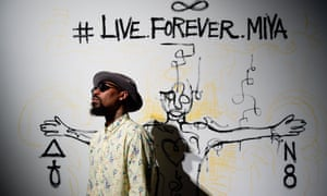 Miya Bailey poses for a portrait in front of a mural he drew for the opening of his solo exhibition, #LiveForeverMiya, at the Notch8 Gallery in Atlanta, Ga. in August 2018.