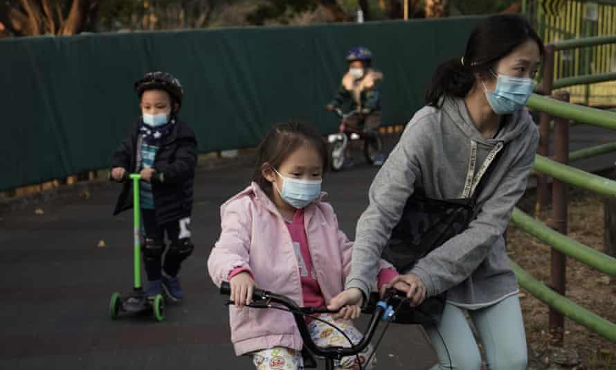 Children on scooters in a Hong Kong park