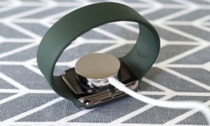 A picture of charging puck clips to the back of the watch via magnets.