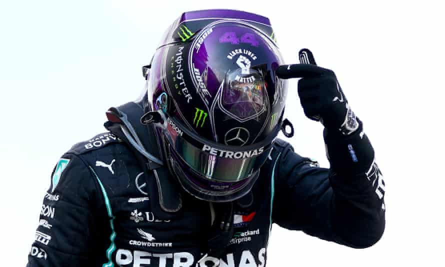 Lewis Hamilton points to the 'Black Lives Matter' symbol on his helmet as he celebrates winning the Spanish Grand Prix in Barcelona.
