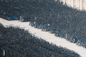 Discarded Bluegogo shared bicycles crammed into a carpark in Beijing