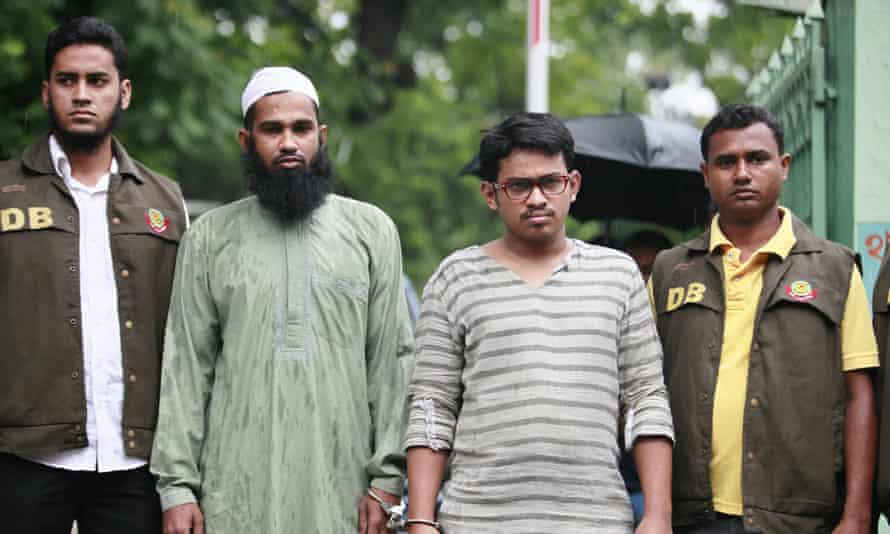 Police have arrested Masud Rana (second from left) and Saad-al-Nahin (third from left) over the murder of blogger Niloy Chakrabarti, who was killed at his home in Dhaka on 7 August.