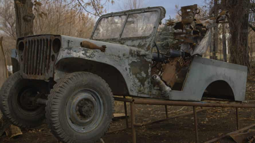 A wrecked car at the Luhansk base of the Night Wolves Russian biker gang