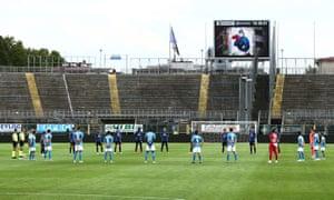 Atalanta and Napoli players observe a minute's silence for coronavirus victims before kick-off.