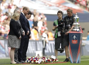 Britain's Prince William, Mayor of Greater Manchester Andy Burnham and FA Chairman Greg Clarke lay wreaths in tribute to the victims of the Manchester attack.