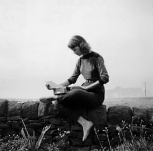 Sylvia Plath with typewriter in Yorkshire (September 1956)