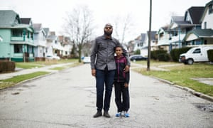 Jamal Collins at the end the street he grew up on in East Cleveland, with his 10-year-old son.
