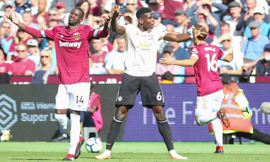 Paul Pogba argues with the referee Michael Oliver (out of picture) as Pedro Obiang remonstrates during Manchester United's defeat at West Ham
