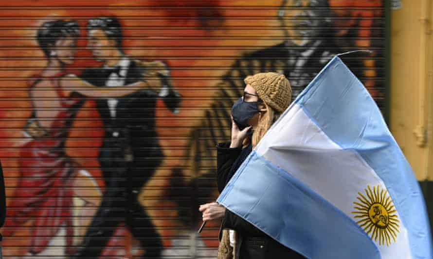 A woman holds an Argentine flag during a protest in Buenos Aires in July against President Alberto Fernández's coronavirus policies.