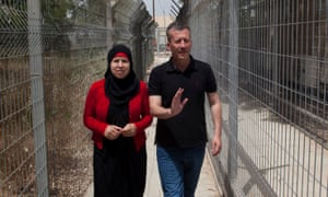 Palestinian activist Bassem Tamimi walks with his wife as they arrive at Israel's Ofer military court near the West Bank city of Ramallah, Tuesday, May 29, 2012.