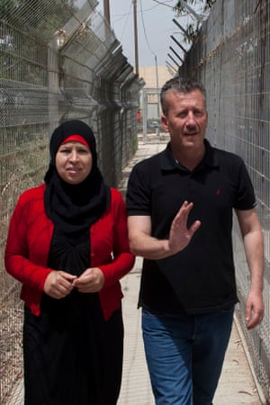 Bassem Tamimi and his wife, Nariman, arrive at an Israeli military court in 2012 where he was sentenced to 13 months' jail for urging youths to throw rocks at soldiers.