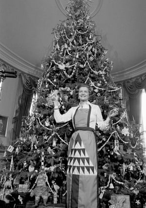 1975 - First Lady Betty Ford holds ornaments to be placed on the White House Christmas tree in the executive mansion.