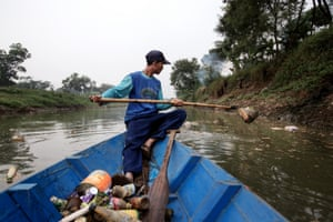 'Scavenger' Mr Iwan, 34, collects recyclable material along the Citarum.