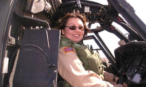 This photo provided by Tammy Duckworth shows Duckworth serving with the Illinois Army National Guard, sitting in a helicopter during her tour of duty in Iraq. (AP Photo/Tammy Duckworth, HO)