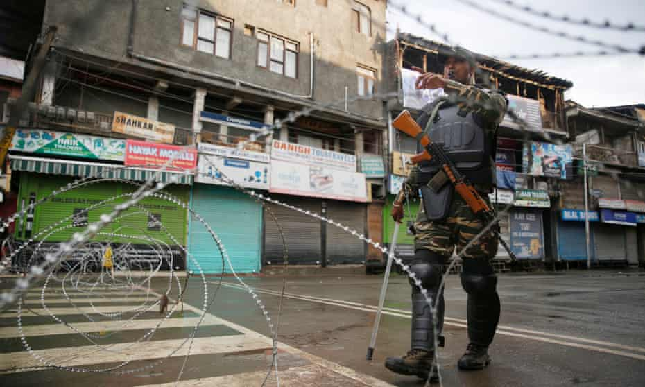 An Indian paramilitary soldier stands enforces the clampdown in Kashmir that followed Dehli's repeal of the territory's special status.