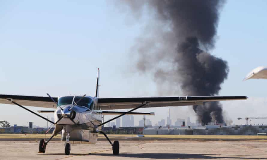 A view from the tarmac at Melbourne's Essendon airport on Tuesday after a charter plane carrying five people crashed into the Direct Factory Outlets.