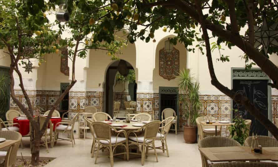 Courtyard setting for tables and chairs at Limoni restaurant in Marrakech, Morocco.