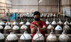 A worker refills oxygen cylinders inside an oxygen factory amid a countrywide lockdown due to the coronavirus in Dhaka. Demand for oxygen is increasing day by day during the Covid-19 pandemic in Bangladesh.