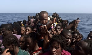 People wait to be rescued by members of the organisation Proactiva Open Arms, in the Mediterranean north of Libya.
