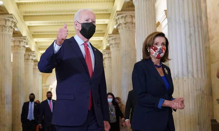 Joe Biden with Nancy Pelosi on Friday.