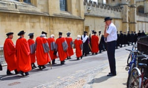 An Oxford University procession with a porter in the foreground.