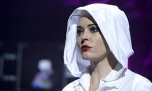 Actor Rose McGowan walks the runway at the Nicholas Kirkwood show at London fashion week.