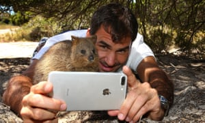 Roger Federer takes a selfie with a quokka at Rottnest Island in Australia