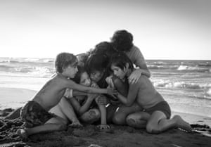 Yalitza Apricio, centre, in Alfonso Cuarón's 'gently sweeping' Roma.