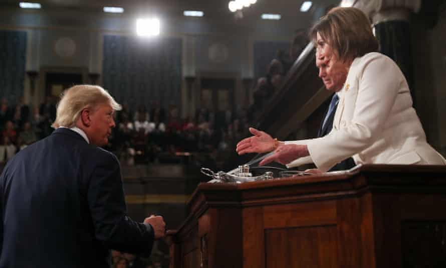 Donald Trump declines to shake Nancy Pelosi's hand before his State of the Union address.