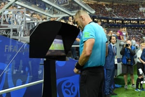 Here's a sight never before seen in a World Cup final – a referee watching action replays. After several reviews, he awards a penalty.