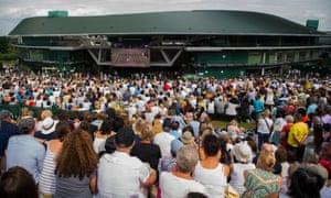 Spectators watch the ladies' singles semi-final between Johanna Konta and Venus Williams at Wimbledon in 2017.