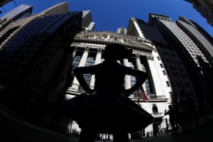 """The """"Fearless Girl"""" sculpture is seen outside The New York Stock Exchange building in New York City."""