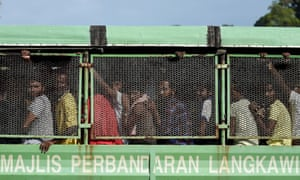 Bangladeshi and Rohingya migrants from Burma arrive at the Malaysian naval base in Langkawi. Malaysia received a better grade than the State Department's human rights experts wanted to give it.