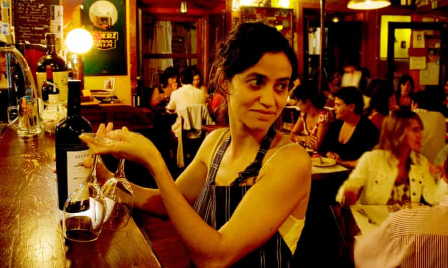 A taste of Portugal: a waitress with wine bottle and two glasses in Lisbon.