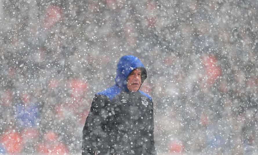 Sam Allardyce in a snowstorm during Everton's 2-1 win at Stoke on 17 March 2018