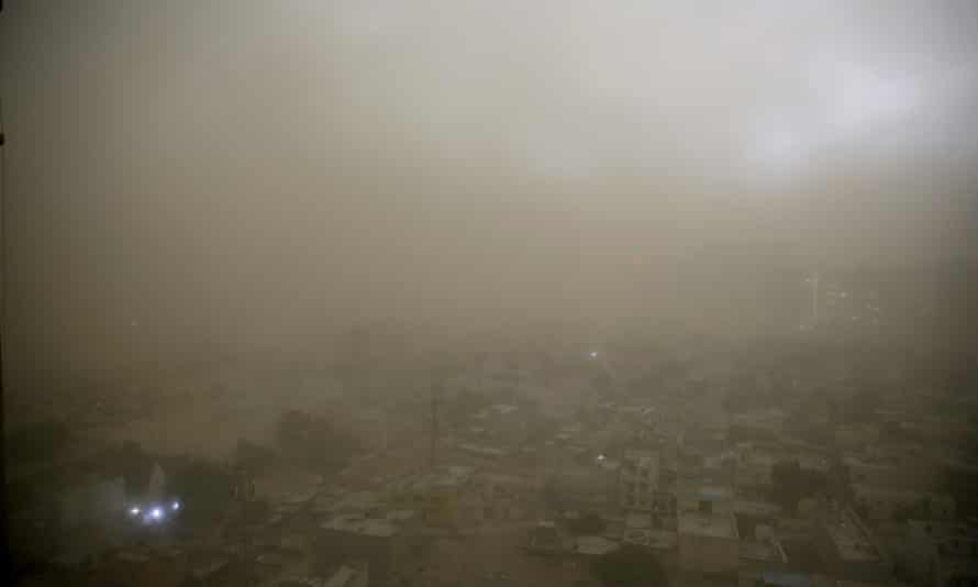 Dust from a storm covers the horizon on the outskirts of New Delhi
