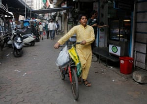 Subhan Shaikh, 14, selling tea from his bicycle in Mumbai.