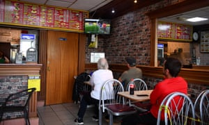 Members of the public watch the game in a cafe near Vicarage Road.