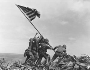 US Marines raise the American flag on Mount Suribachi, Iwo Jima, in 1945.