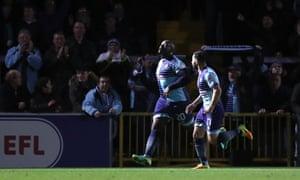 Adebayo Akinfenwa, left, celebrates scoring Wycombe's winner against Stourbridge in the FA Cup third round.