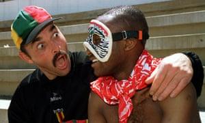 Bruce Grobbelaar, left, shares a joke with his Zimbabwe team-mate Peter Ndlovu.