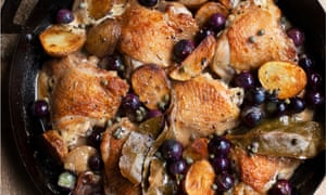 Chicken with grapes, cider and cream in a pan