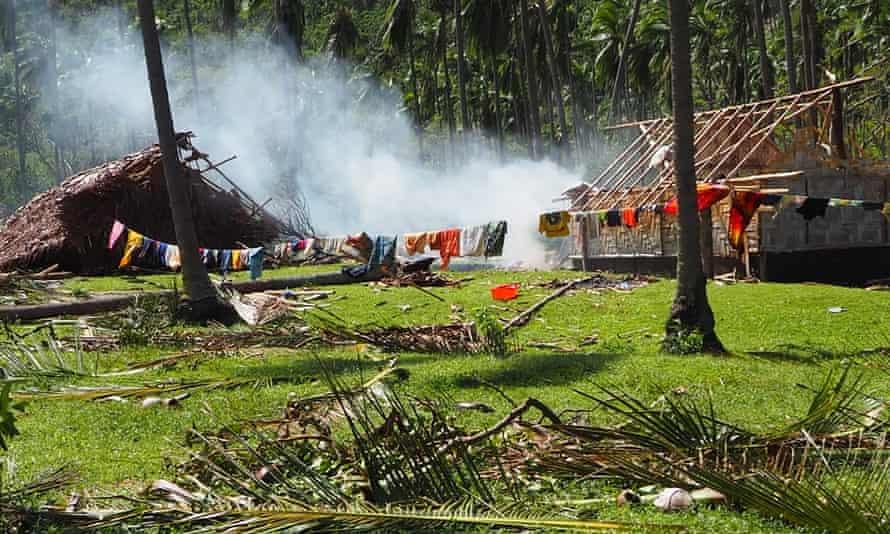 Clothes dry on a line outside roofless homes in Kerevinopu Village on Vanuatu's Espiritu Santo Island.