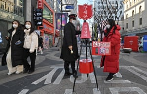 Seoul, South Korea A Salvation Army officer sets up a collection for a fundraising campaign in the Myeongdong shopping district