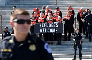 """Washington D.C, USActivists from Amnesty International, America's Voice, the Council on American-Islamic Relations (CAIR) and Church World Service (CWS) hold a civil disobedience protest against """"the decimation of the U.S. refugee resettlement program """" in front of the US Capitol"""