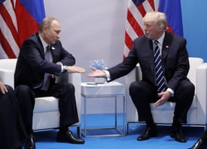 Russia's President Vladimir Putin (L) and US President Donald Trump shake hands during a bilateral meeting on the sidelines of the G20 summit in Hamburg.