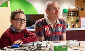 Shay Murray and his father Alan using the Xbox Adaptive controller.